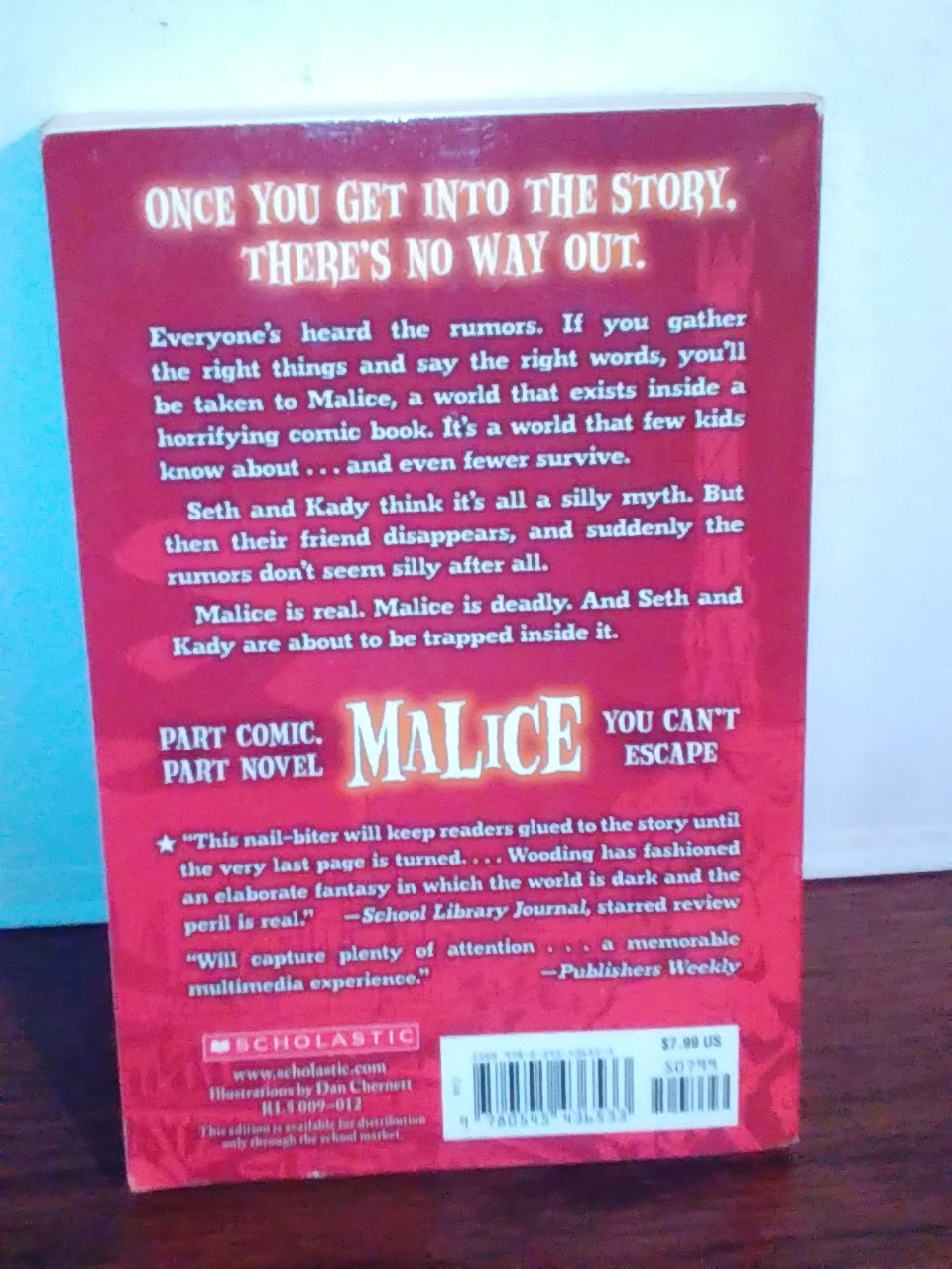 Malice by Chris wooding a Scholastic book