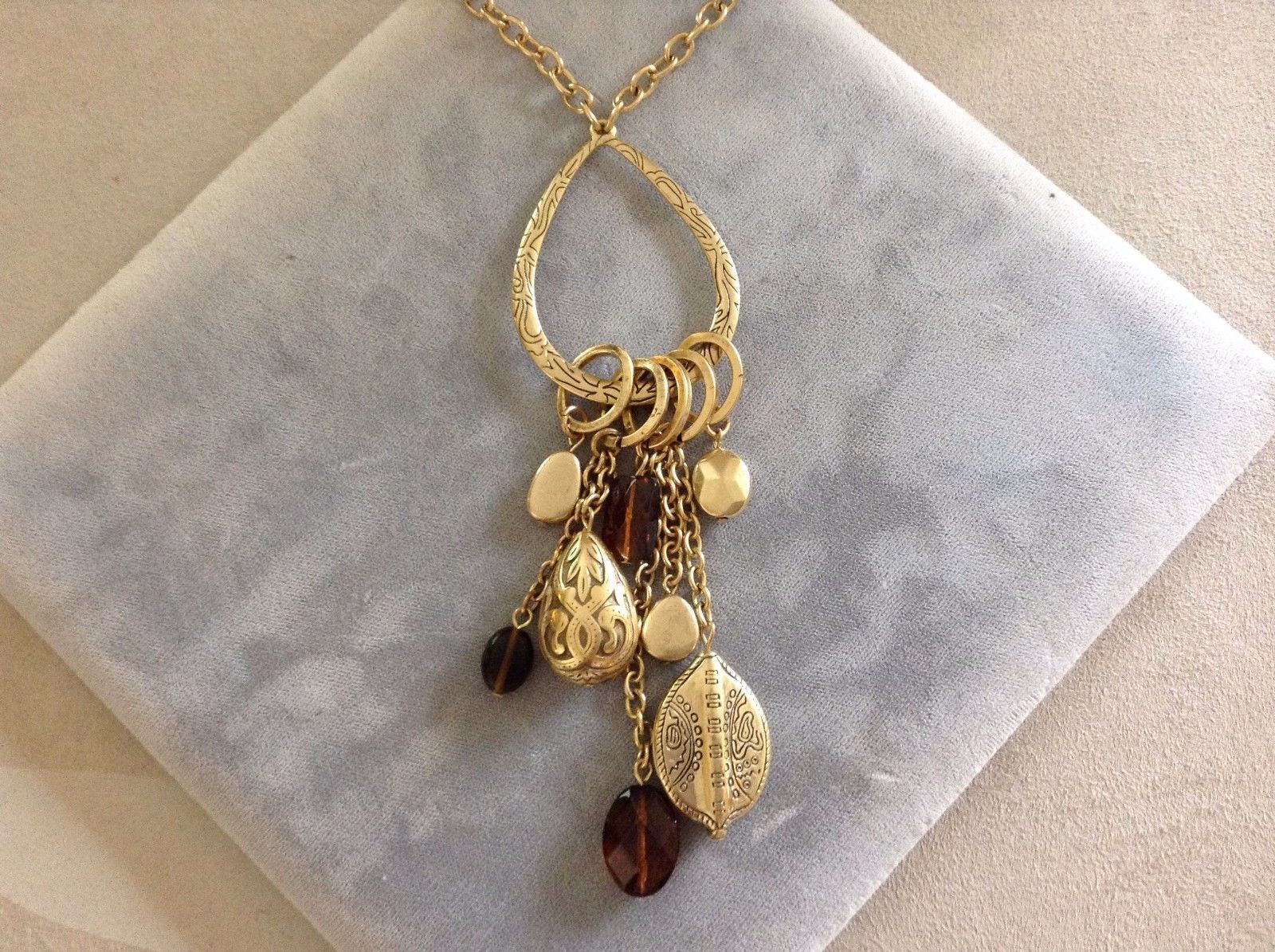 New Allure Gold Toned Necklace with Charms Pendant Amber Colored
