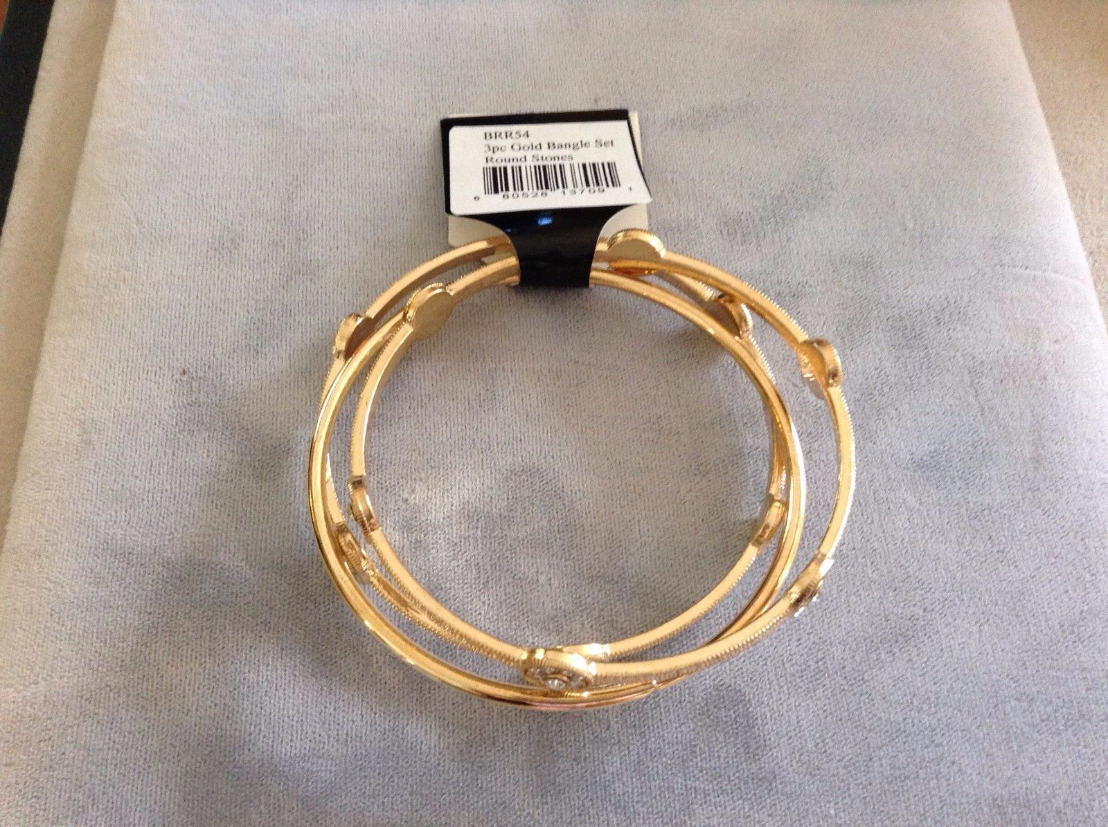 New Three Piece Gold Toned Bangle Bracelet Set With Round Stones