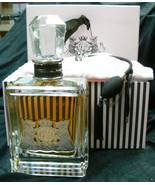 """JUICY COUTURE 20 oz PERFUME COLLECTORS NUMBERED 11""""H,5 1/2 """" L.3 1/2 """" W... - $812.25"""
