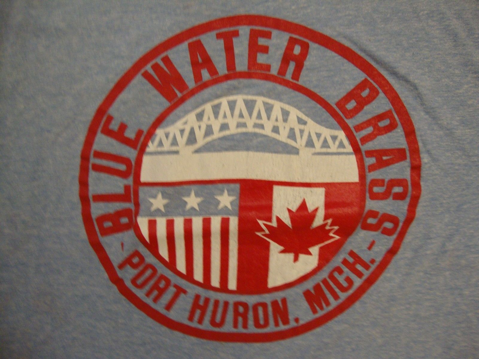 Primary image for Vintage Blue Water Brass Michigan Canada Bridge Champion blue bar tag T Shirt M