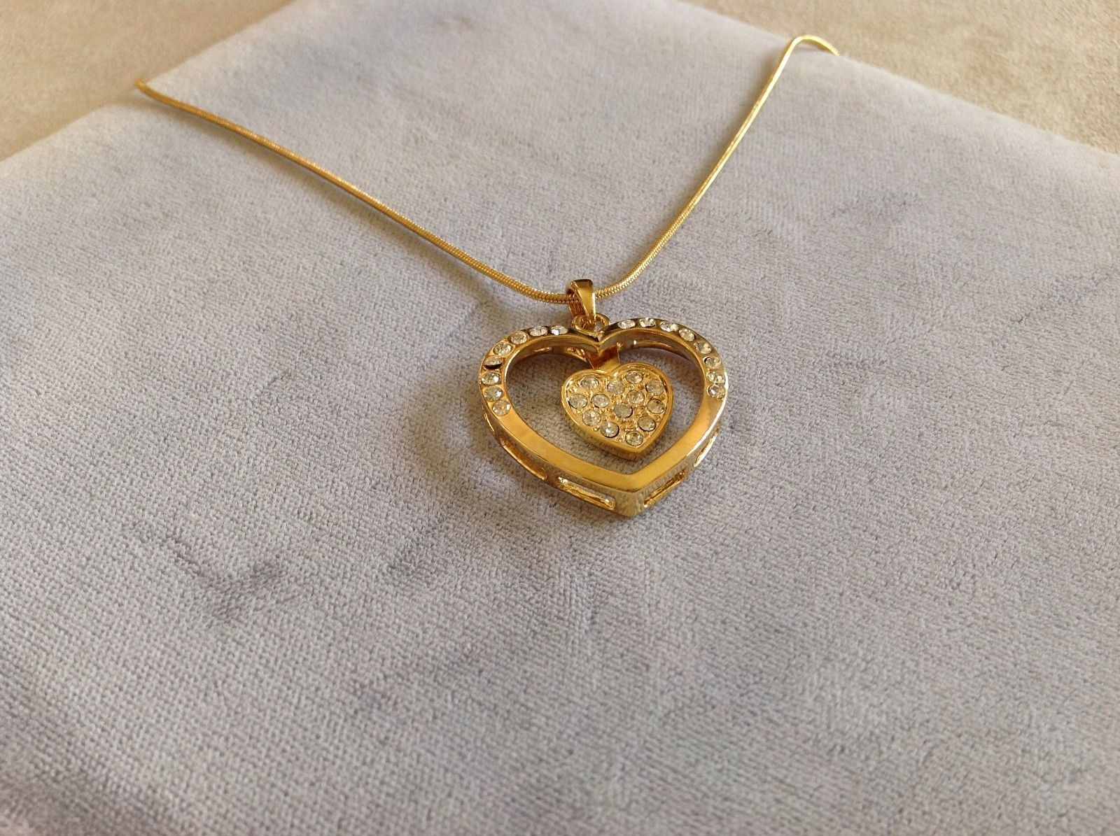 New Allure Gold Toned Necklace With Heart Shaped Pendant Decorated With Gemstone