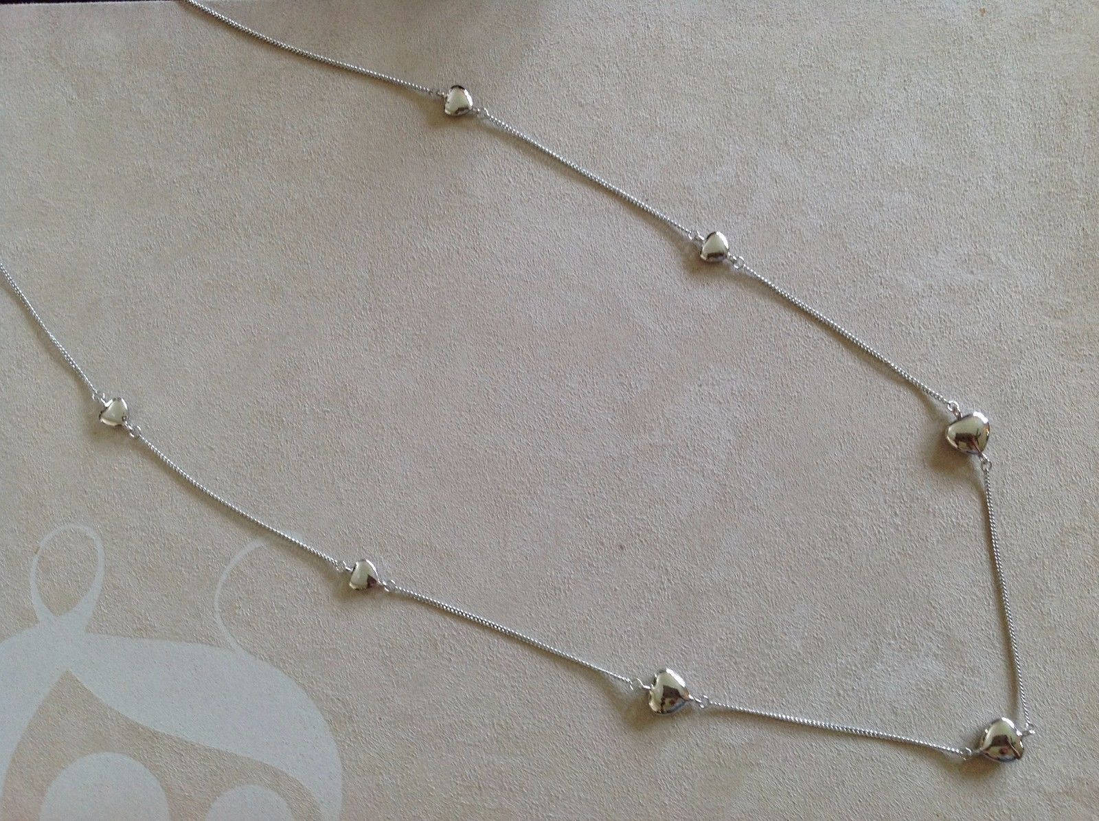New Allure Necklace Silver Toned Chain Strung With Hearts