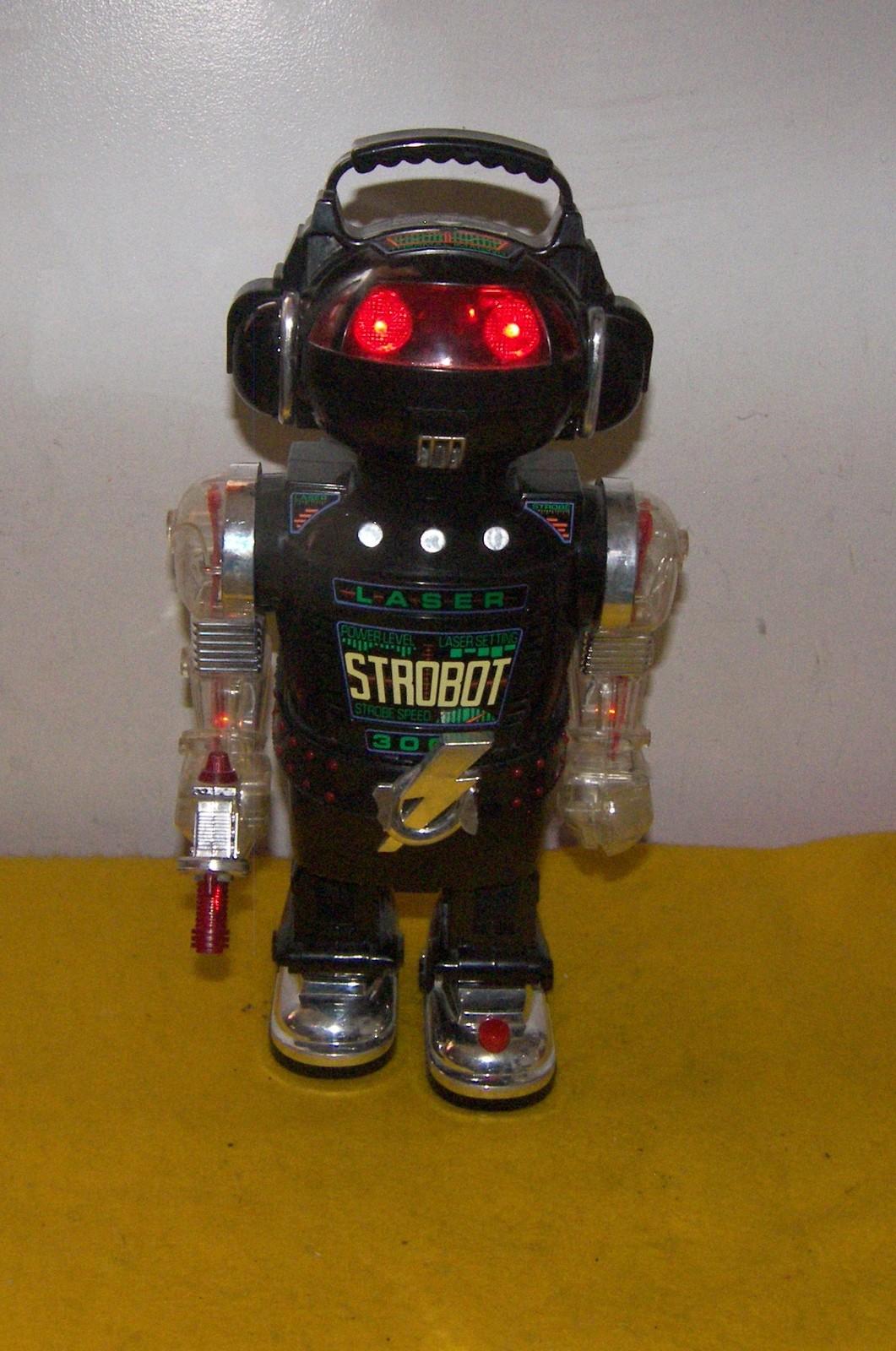 Vintage Strobot Robot Walking / Smoking / Lights / Lacer Sound