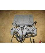 Original Gray Playstation Game Console and Controllers - $100.00