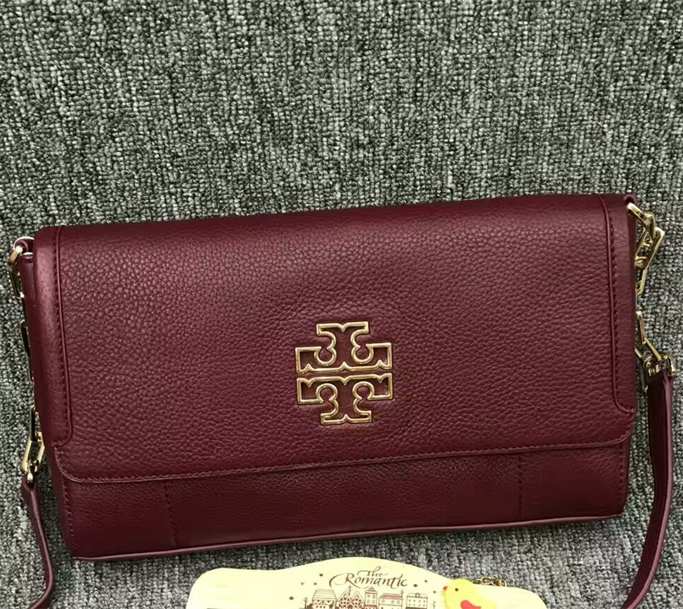 c1c32f8817b7 Mmexport1489150970238. Mmexport1489150970238. Tory Burch Britten Fold-over  Messenger Crossbody Bag