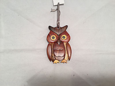 Hand carved multi colored brown shades grained wood owl ornament double sided