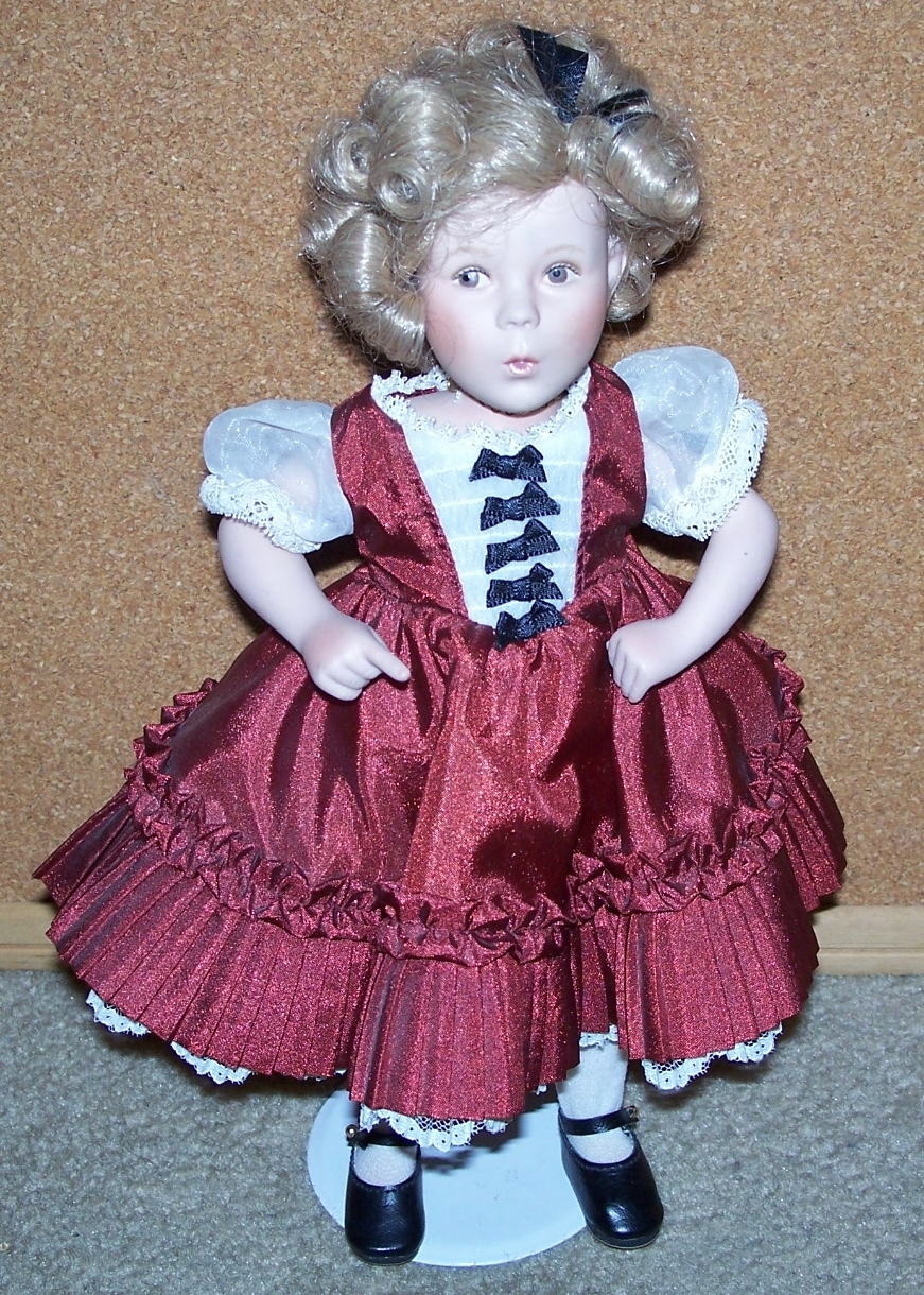 COLLECTIBLE ELKE HUTCHINS SHIRLEY TEMPLE PORCELAIN DOLL W/ STAND