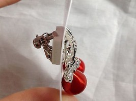 Swarovski silver tone clear bow stone red bubble screw back clip on earrings image 4