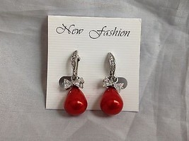 Swarovski silver tone clear bow stone red bubble screw back clip on earrings image 2