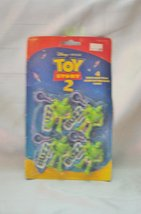 Four Buzz Lightyear Glow in the Dark Clips - For Backpacks, Purses - $12.82