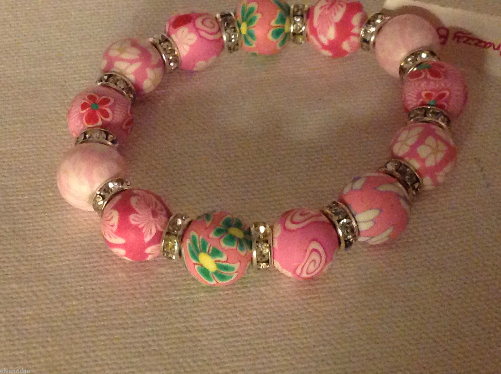 Pink and green millifiori stretchy bracelet with crystal spacers made in USA
