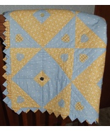 Blue yellow diamond quilt over chair thumbtall