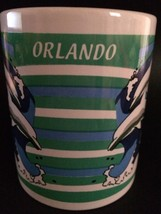 LARGE ORLANDO FLORIDA COFFEE MUG DOLPHINS OCEAN WAVES BLUE GREEN WHITE  - $7.87