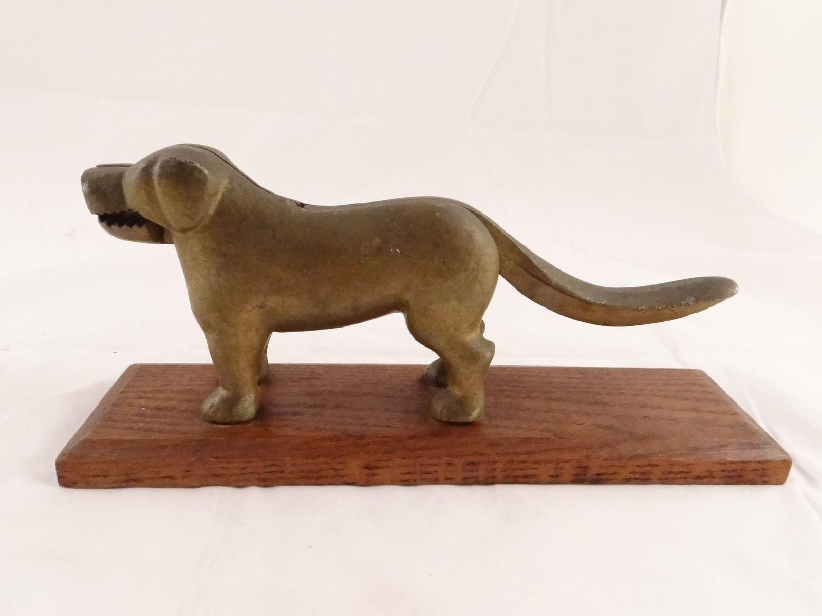 VINTAGE CAST IRON NUTCRACKER DOG ON WOODEN BASE