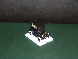 "DEPT 56 CHRISTMAS IN THE CITY ACCESSORY.MOVABLE WHEELS.FORD.""1919 FORD M... - $19.79"