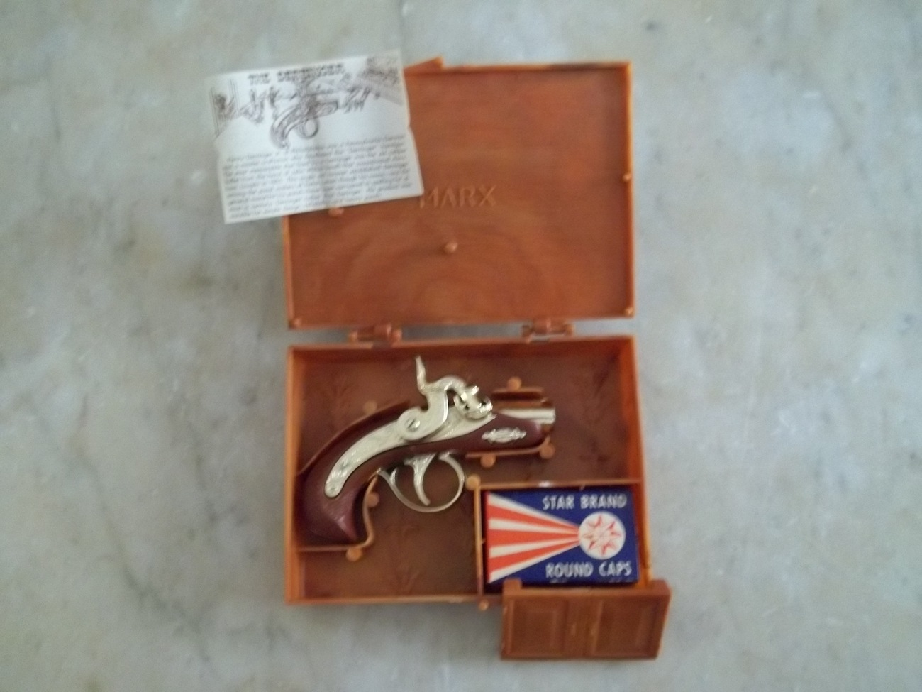 Marx original golden derringer cap gun in case w/ paperwork & caps