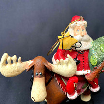 Santa Claus Riding On A Moose Swinging Legs Christmas Ornament - $17.82