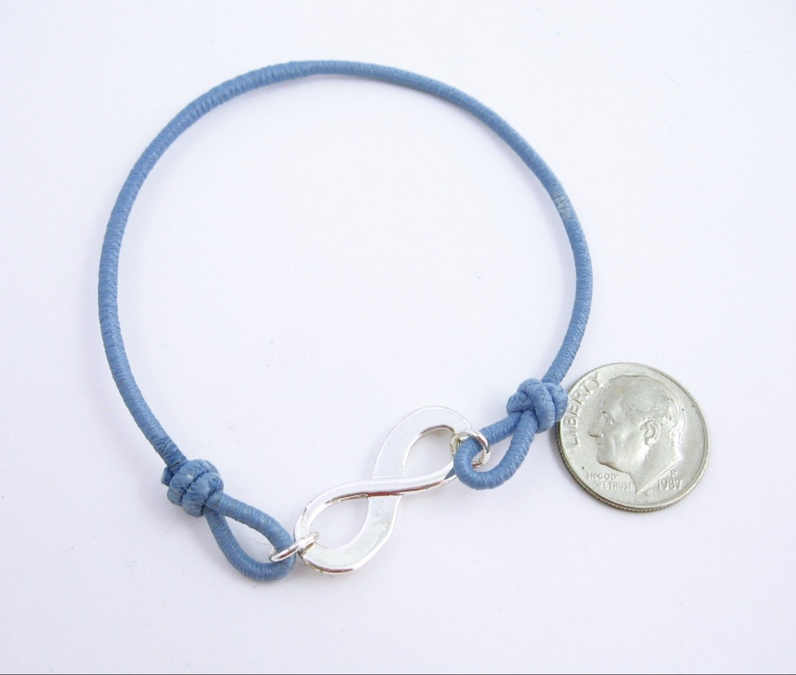 Avon EMPOWERMENT Blue BRACELET In BOX Silvertone INFINITY Charm Size Large NIB