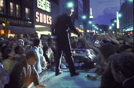 Robert F Kennedy greets a crowd from atop a car while campaigning in 1968 - $7.18