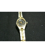 Vintage Nelsonic Diamond Quartz Gold Tone Women's Flexible Wrist Band Watch - $8.41