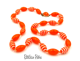Hong Kong Vintage Necklace with Orange Beads and Painted White Stripes - $16.00