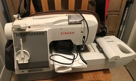 Singer CE-100 Futura Computerized Sewing Machine - Powers On, With Pedal And Man - $158.44 CAD