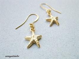 Starfish earrings, Gold starfish earrings, Gold dangle earrings. - $15.00
