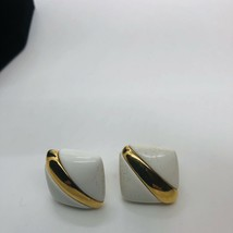 Pretty Pre Owned Signed Monet White And Goldtone Clip On Earrings - $7.91