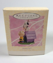 Hallmark MIB Peanuts Charlie Brown Snoopy Dog House Easter Beagle Ornament - $14.95