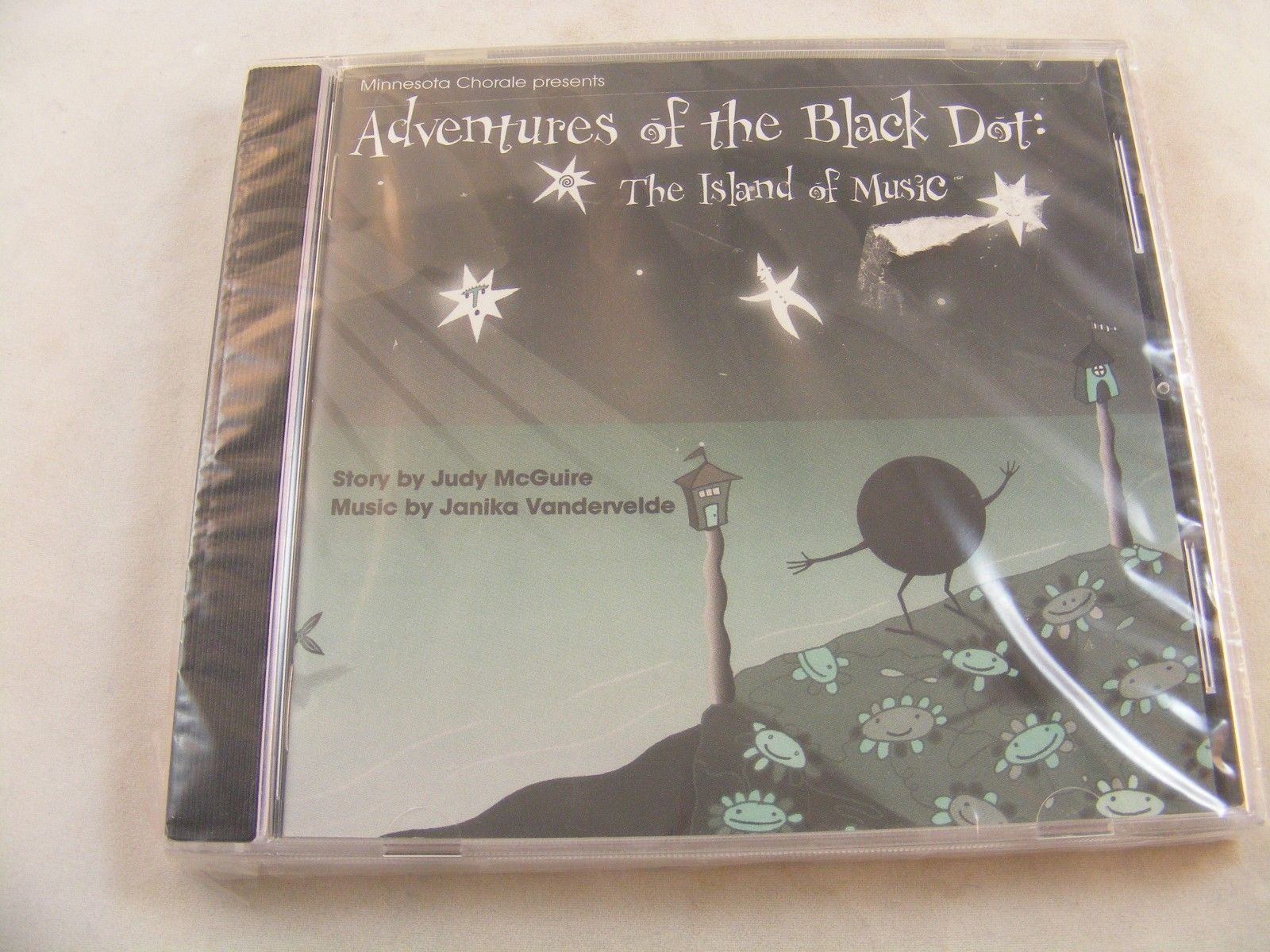 Adventures of the Black Dot.- The Island of Music - Musical Story Book - New/Sea