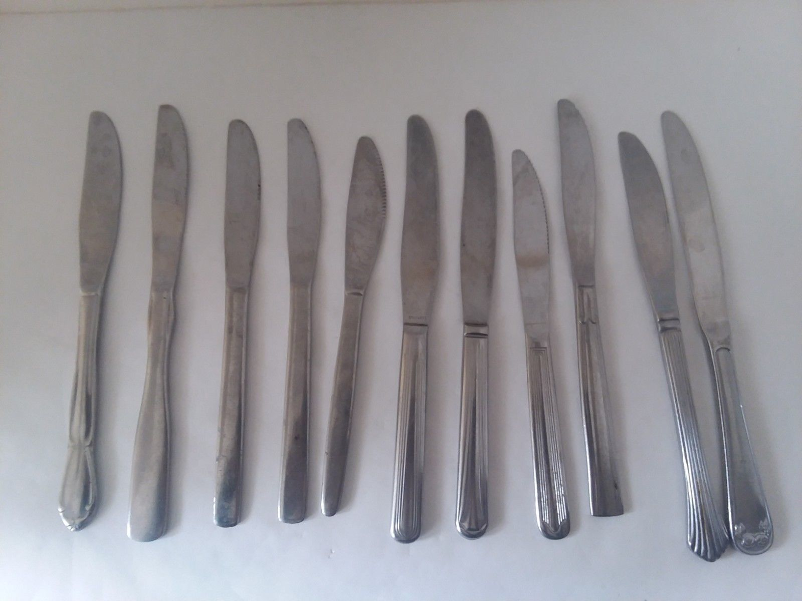 Primary image for 11 Misc. Lot of Stainless Steel Butter Knives Mixed Pattern Cutlery Crafts DIY