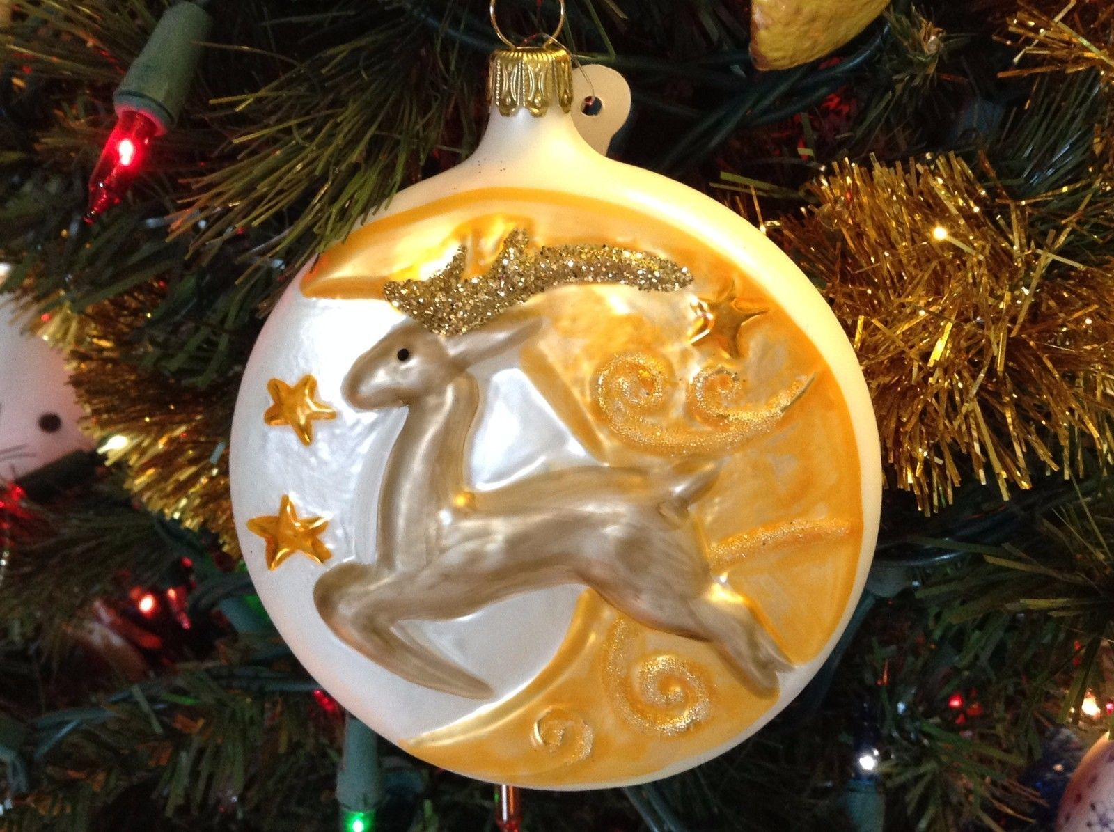 Blown glass Brown flying Reindeer over crescent moon hand painted ornament