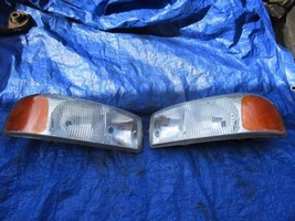00-06 GMC Sierra OEM driver passenger headlight assembly set LH RH SLT S... - $139.99