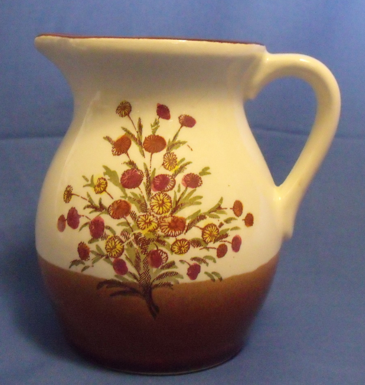 Brown and cream creamer pitcher