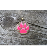 PAW PRINT GLOW IN THE DARK Round Metal Pendant Charm Necklace Cat Wolf D... - $11.50