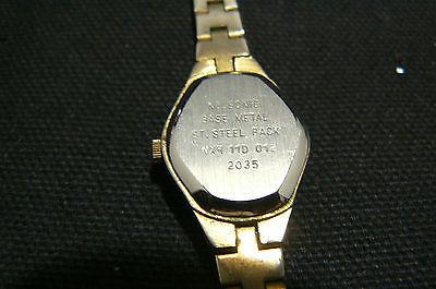 Vintage Nelsonic Diamond Quartz Gold Tone Women's Flexible Wrist Band Watch