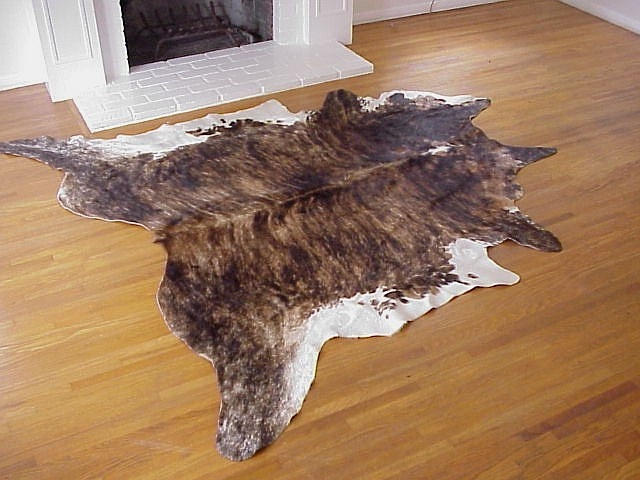 Dark brindle with white belly natural cowhide rug