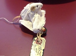 Miniature mouse doll with ghost costume and trick or treat bucket and candy corn