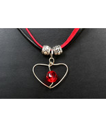 Necklace with Swarovski crystal in heart frame on black leather & red su... - $28.00