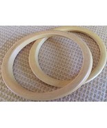 VINTAGE/RETRO COLLECTIBLE  PAIR OF OFF WHITE OVAL SHAPED BANGLE BRACELETS - $9.45