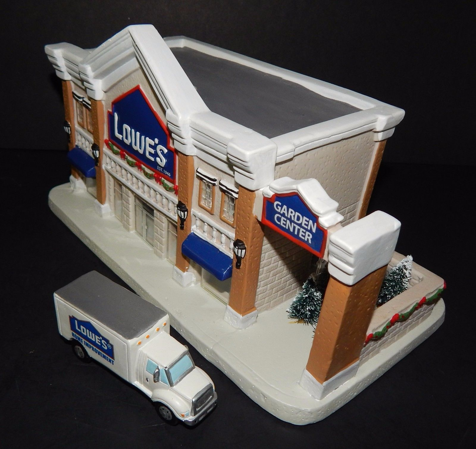 lowes 65th anniversary lighted porcelain building santas best christmas village