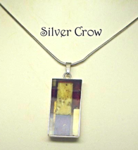 Sterling Silver Brown and Ivory Resin Pendant Necklace - $29.99