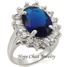 HCJ SILVER TONE 6 CT OVAL MONTANA BLUE 4 PRONG CZ ENGAGEMENT RING SIZE 5 - $18.48