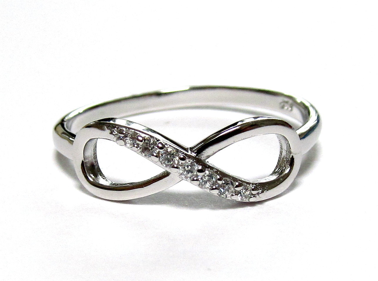 Adorable Silver Infinity Ring with hand set CZ stones