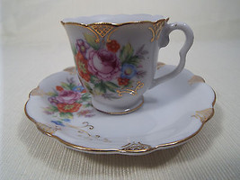 Ucagco Occupied Japan Demitasse Cup and Saucer Multi Floral with Gold Trim - $22.99