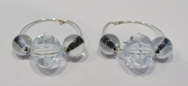 handmade silver hoop earrings with clear glass beads with black centers - $9.00