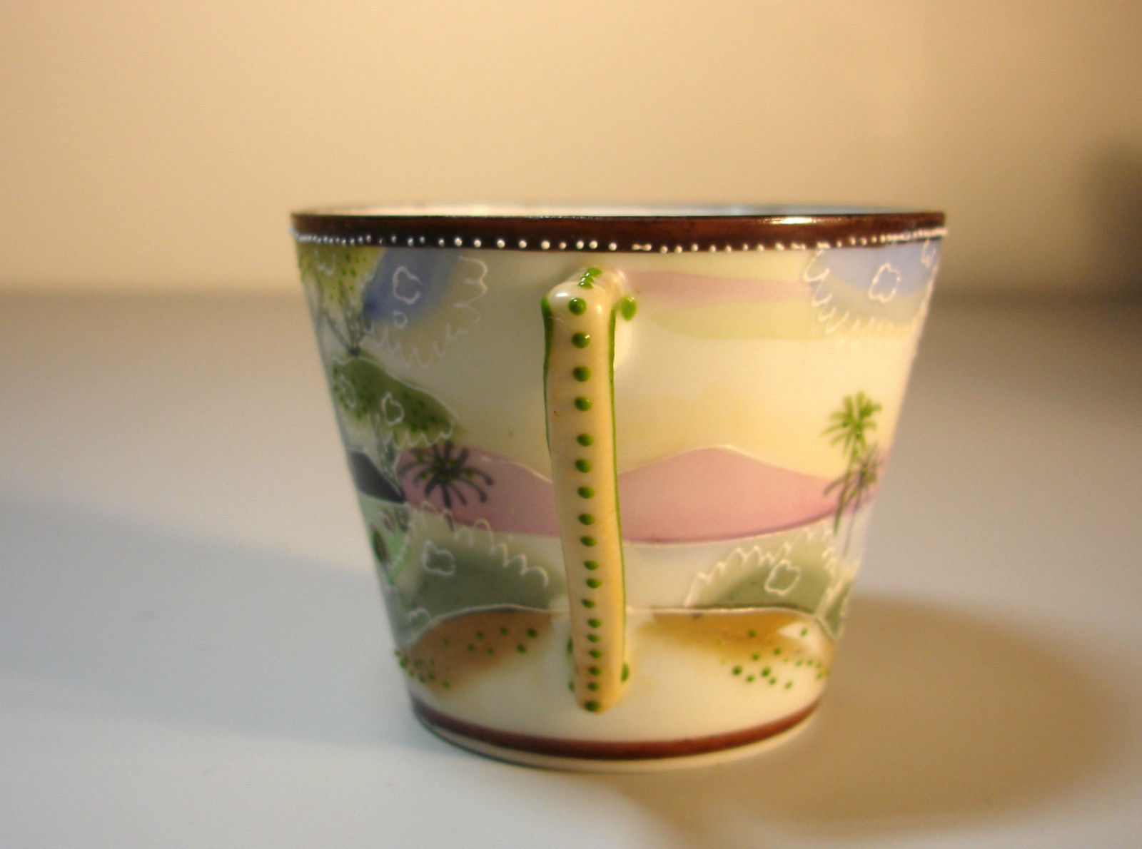 NIPPON Moriage Beaded Hand Painted Cup and Saucer