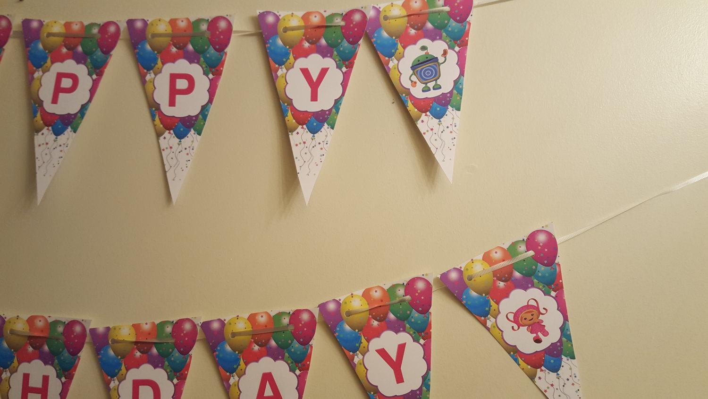 "Team Umizoomi banner that says ""Happy Birthday"""