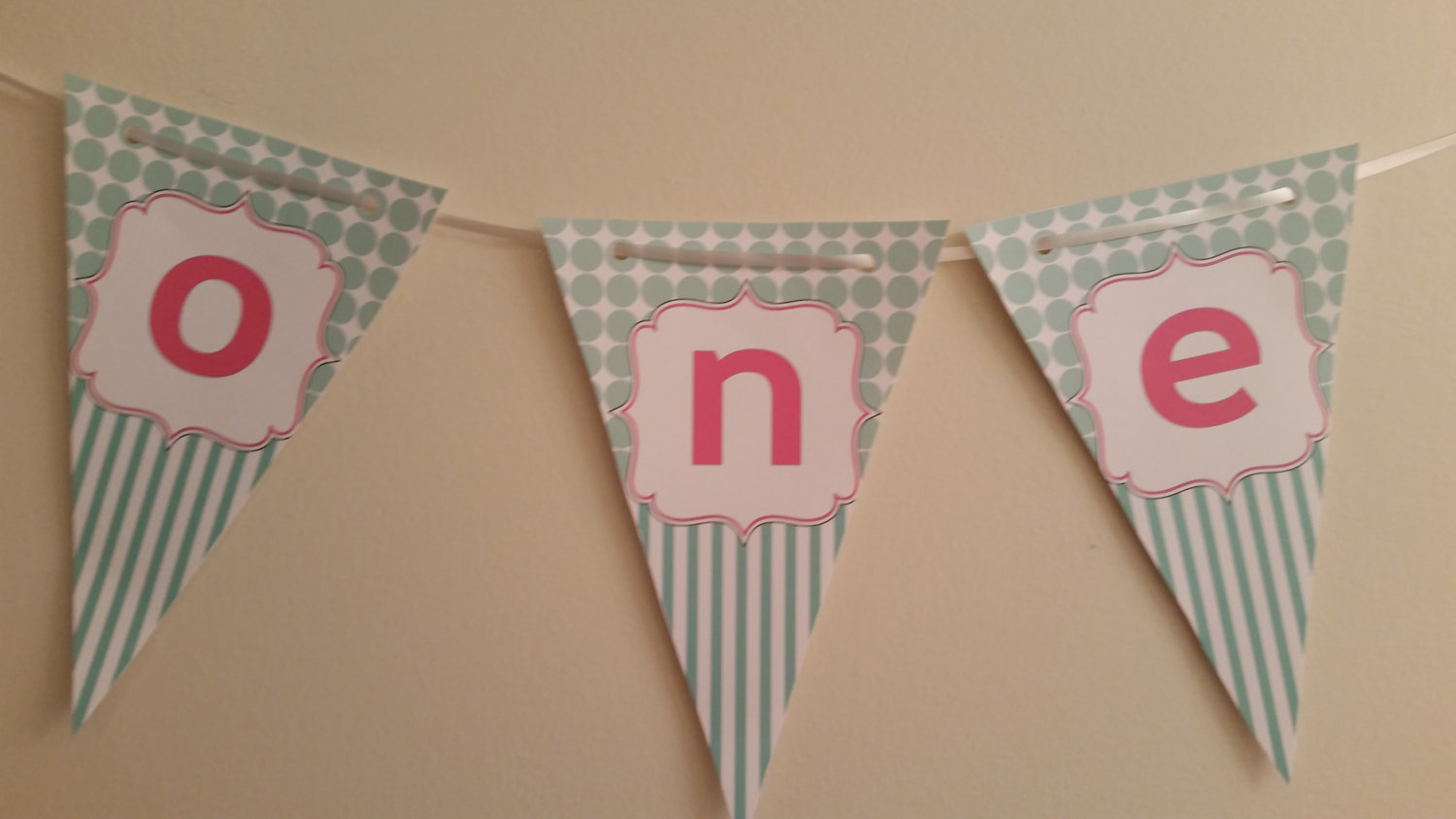 """Aqua and pink """"one"""" high chair banner"""